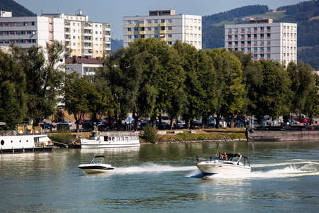 the capital of upper austria in austria is linz. powerboats urfahr Stock Photo
