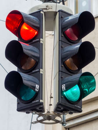 standstill: a traffic light with red and green light at an intersection