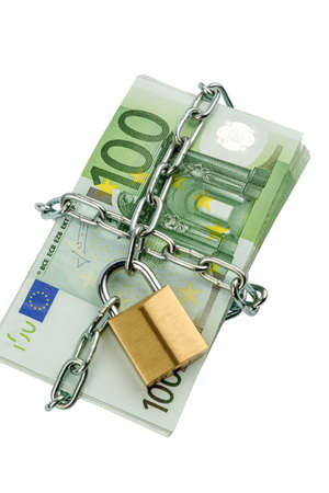 euro banknotes with chain and padlock. symbolic photo for security and inflation. photo