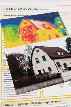 save heating costs: saving energy through thermal insulation. house with thermal imaging camera photographed. Stock Photo