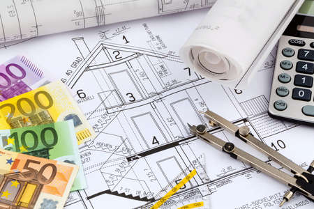 single familiy: an architects blueprint with a calculator and euro money. symbolic photo for funding and planning of a new house.