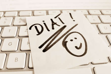 thinness: a sticky note is on the keyboard of a computer as a reminder: diet Stock Photo