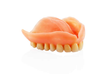teeth against white , symbol photo for dentures, diagnosis, and co-payment photo
