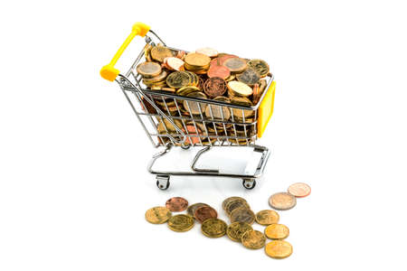stocked: a shopping cart is well stocked with euro coins, symbolic photo for purchasing power and consumption Stock Photo