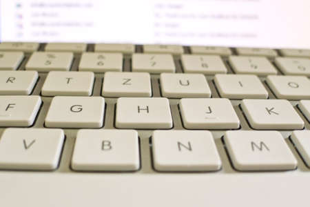 edv: the keys of a computer in close-up. data processing and the internet. Stock Photo
