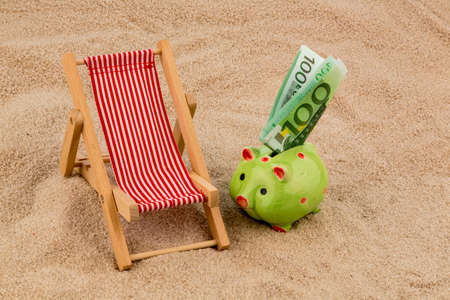 beach chair with euro currency on the sandy beach. symbolic photo for travel costs, vacation, holiday photo