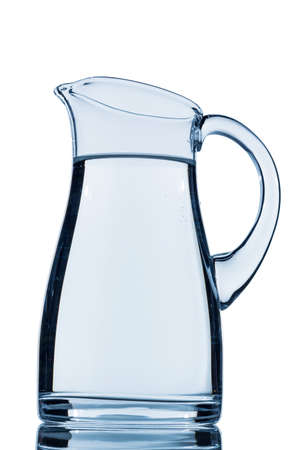 hydrology: a pitcher of water against white background, symbol photo for drinking water, water demand and consumption