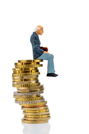 pensioners sitting on a pile of money, symbolic photo for pension, retirement, old-age security photo