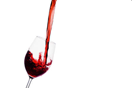 peppy: in a glass of red wine peppy is empty. red wine in wine glass Stock Photo