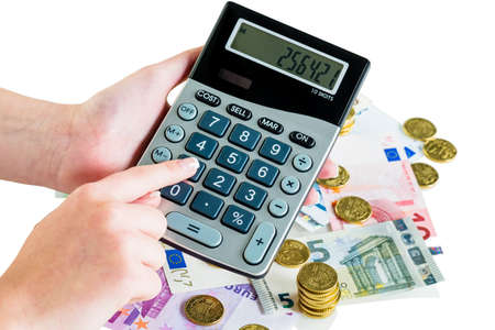 turnover: hand with calculator and bills. symbolic photo for turnover, profit, taxes and costing