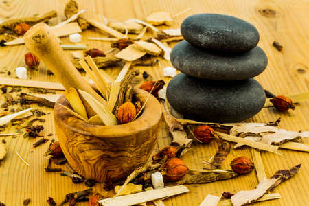 and traditional chinese medicine: ingredients for a cup of tea in traditional chinese medicine. cure of diseases by alternative methods. Stock Photo