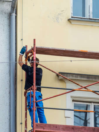 work worker workforce world: construction workers build a scaffolding at a construction site