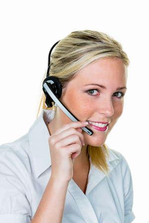 een jonge vrouw met headset symbolfoto voor hotline, klantcontact en telefoon Stockfoto