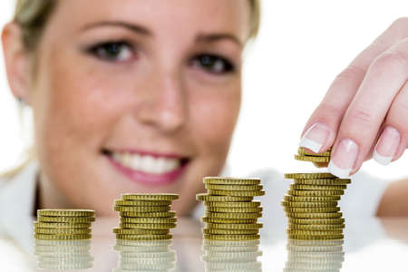 precaution: a young woman stacks coins  save icon photo for growth precaution  Stock Photo