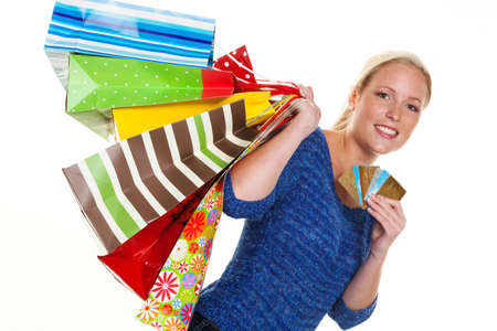 unbar: a young woman with colorful shopping bags while shopping  using credit cards for cashless payment