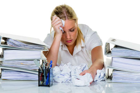 loads: young woman in office is overwhelmed with work  burnout in work or study  Stock Photo