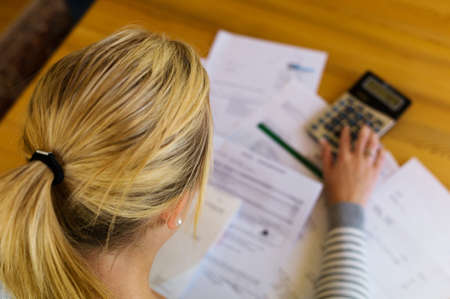 insolvency: a woman with unpaid bills has many debts  unemployment and personal bankruptcy