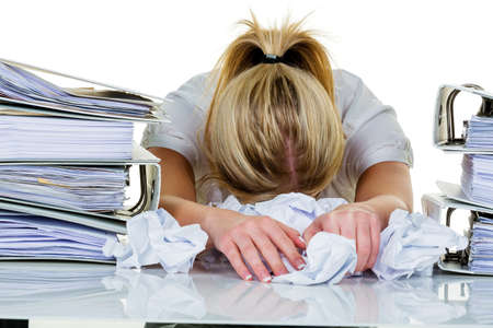 burn out: young woman in office is overwhelmed with work  burnout in work or study  Stock Photo