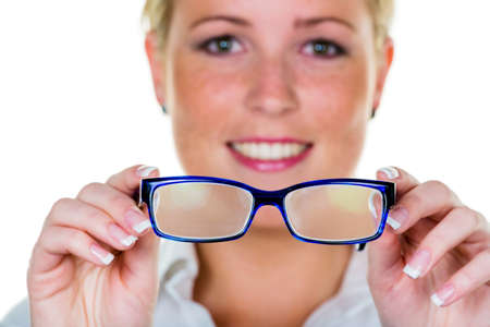 farsighted: a woman holding glasses in hand  symbolic photo for bad vision and refractive error