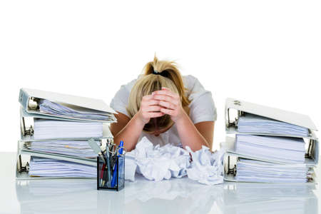 revised: young woman in office is overwhelmed with work  burnout in work or study  Stock Photo