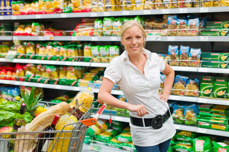 grocers: a woman when buying groceries in a supermarket  everyday life of a housewife