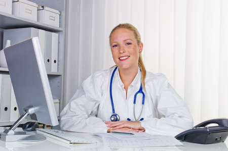 practical: a young doctor with stethoscope in her doctor s office  Stock Photo