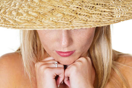 insipid: a young pensive woman with straw hat  portrait against white background