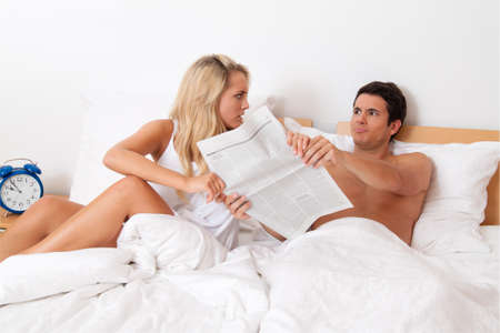 a young couple in bed has problems and crisis  divorce and separation  Stock Photo - 26509114