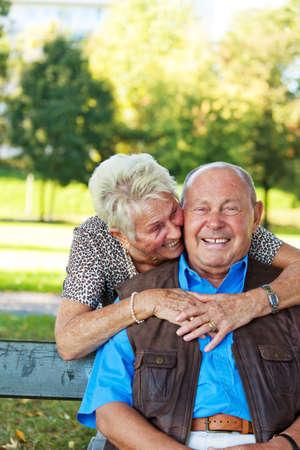 elderly seniors couple in love  man hands over a rose  Stock Photo