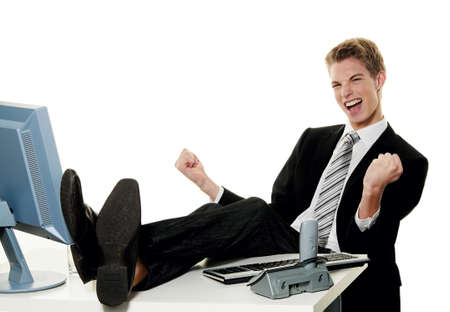 entrepreneurs: a successful young entrepreneurs at desk in office Stock Photo