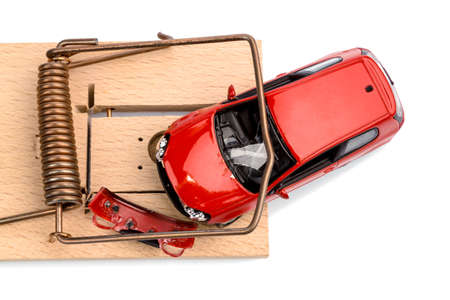 debt trap: a model car in a mousetrap, symbolic photo for car expenses and liabilities