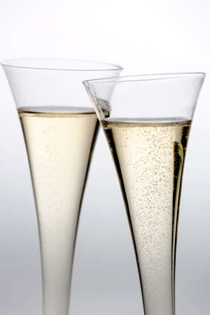champagne or sparkling wine in a champagne glass  symbolic photo for celebrations, new year and good mood