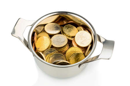 financially: a cooking pot, half filled with euro coins, symbolic photo for sovereign debt and financial needs