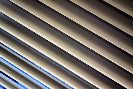 lamellar: to protect against heat and sun blinds are attached to a window
