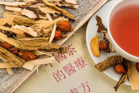ingredients for a cup of tea in traditional chinese medicine  cure of diseases by alternative methods  photo