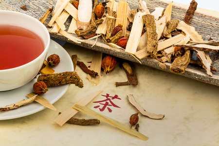 naturopaths: ingredients for a cup of tea in traditional chinese medicine  cure of diseases by alternative methods