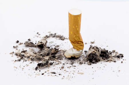non: stop smoking  on the muffled cigarette on white  Stock Photo