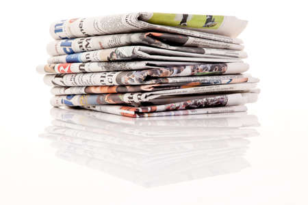 magazine stack: old newspapers and magazines in a pile