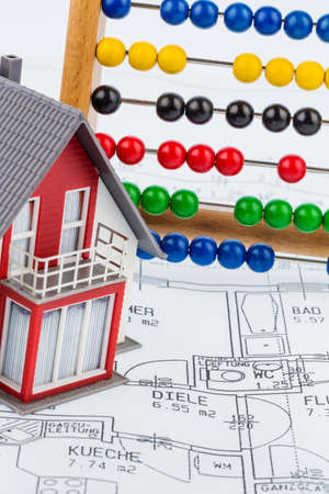 home planning: house, abacus, plan, symbol photo for house construction, financing, building society