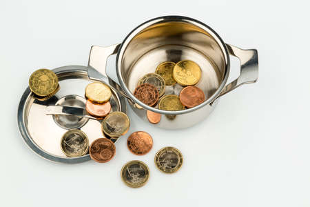 budgetary: a cooking pot with a few euro coins