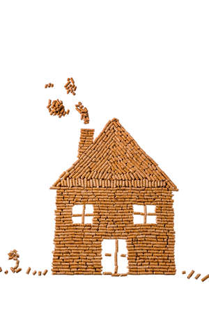 a house built of pellets for heating alternative and sustainable energy for heating Stock Photo
