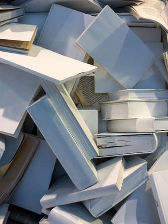 messed up: many books are completely messed up on a pile