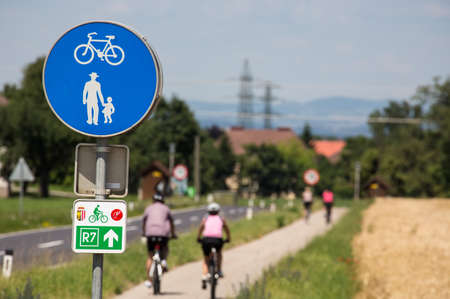 adjacent: a combined cycle and walkway  cyclists and pedestrians adjacent  Stock Photo