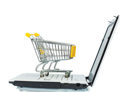 consumerist: an empty shopping cart on a laptop computer  symbolic photo for shopping on the internet