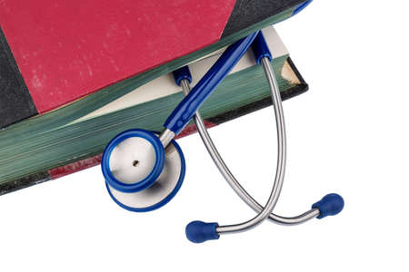 physicans: book and stethoscope, symbol photo for bungling, doctors errors and expertise