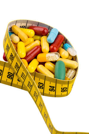 thinness: tablets and measuring tape, symbol photo for appetite suppressant, diet pills and thinness Stock Photo