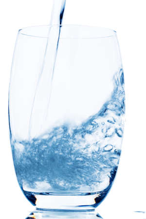 water is poured into a glass, symbol photo for drinking water, freshness, demand and consumption photo