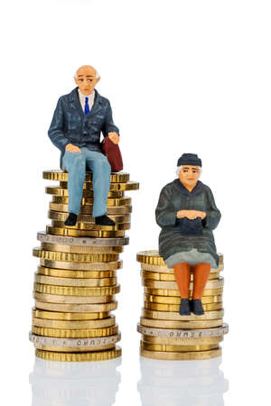 pensioners and pensioner sitting on money stack, symbol photo for retirement and inequality, photo