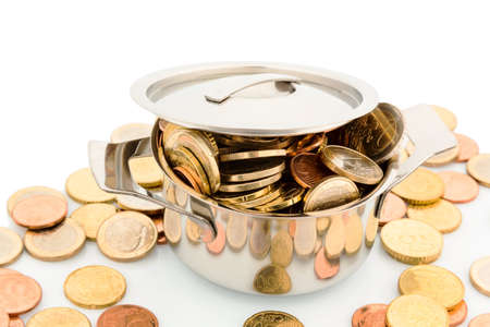 subsidize: a pressure cooker is filled with euro coins, symbolic photo for funding Stock Photo