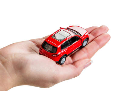 fully comprehensive: a hand holding the model of a car  symbolic photo for car purchase Stock Photo